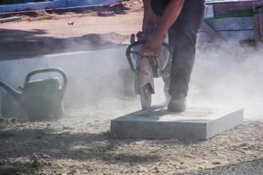 stone masons cutting